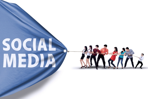 People Pulling a Banner Of Social Media